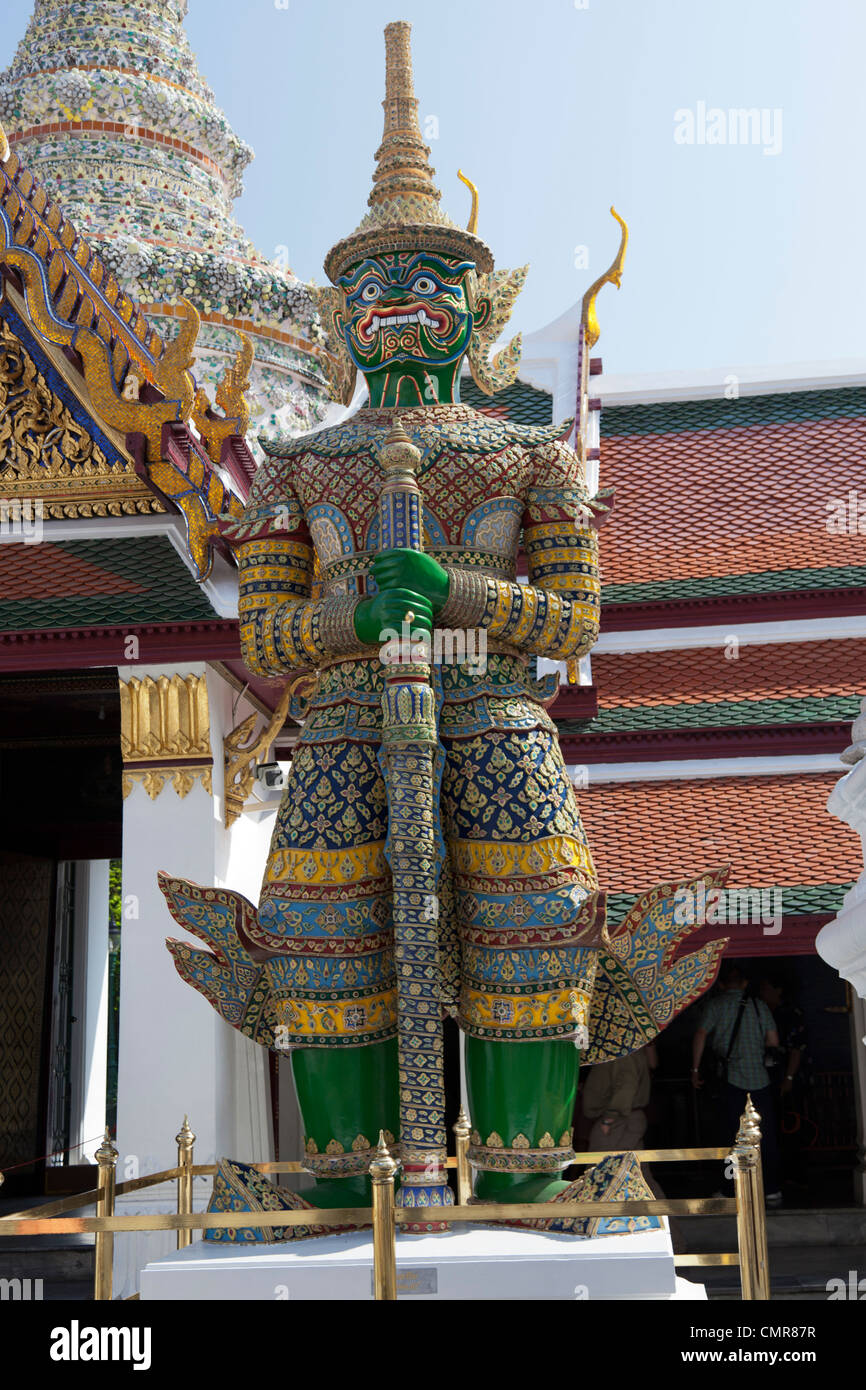 A Demon-Guard standing on the watch outside one of the buildings of the Phra Kaeo Temple (Bangkok - Thailand).  - Stock Image