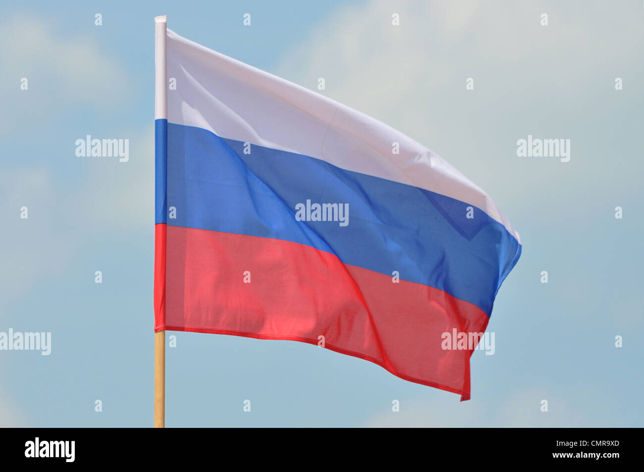 Flag of Russian Federation against blue sky - Stock Image