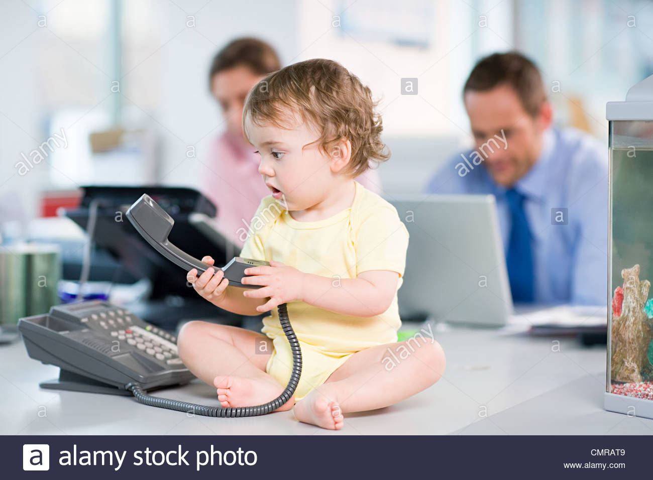 Baby with telephone - Stock Image