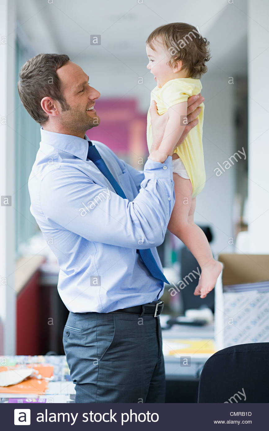 Office worker and his baby - Stock Image
