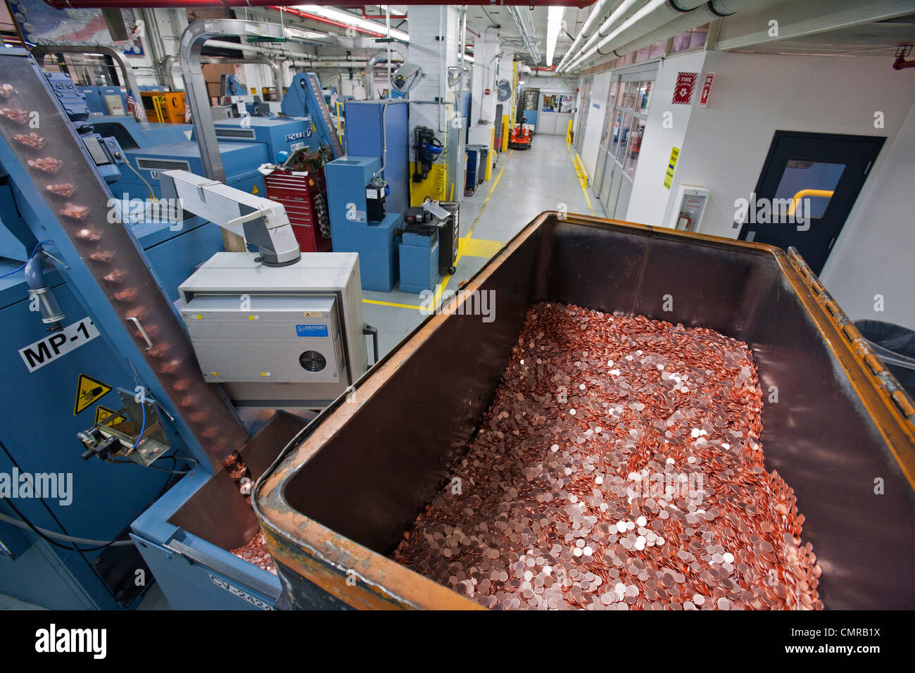 Denver, Colorado - Production of coins at the United States Mint. A bin holds blank shapes that will be turned into - Stock Image