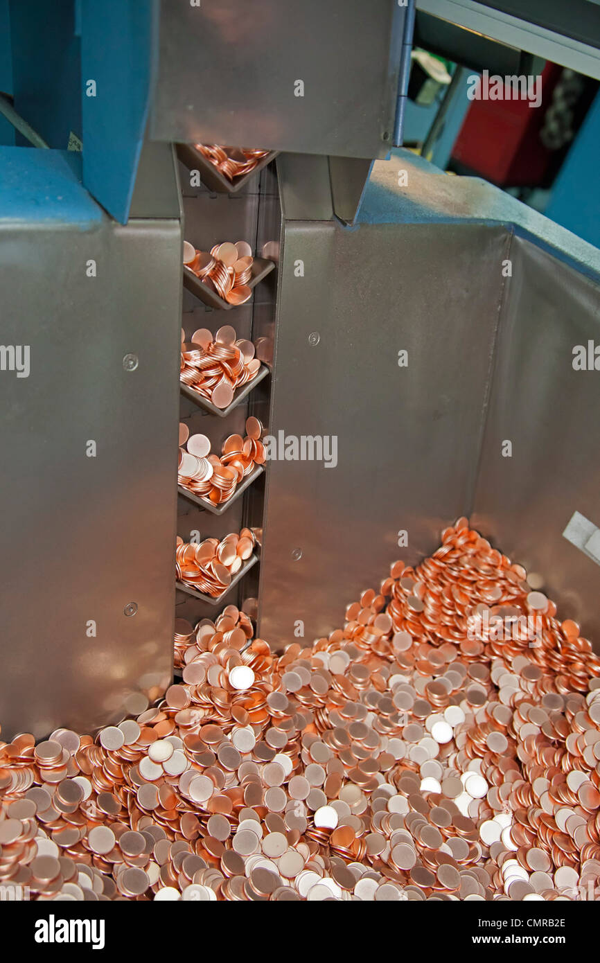 Denver, Colorado - Production of coins at the United States Mint. A machine produces blanks which will be turned - Stock Image