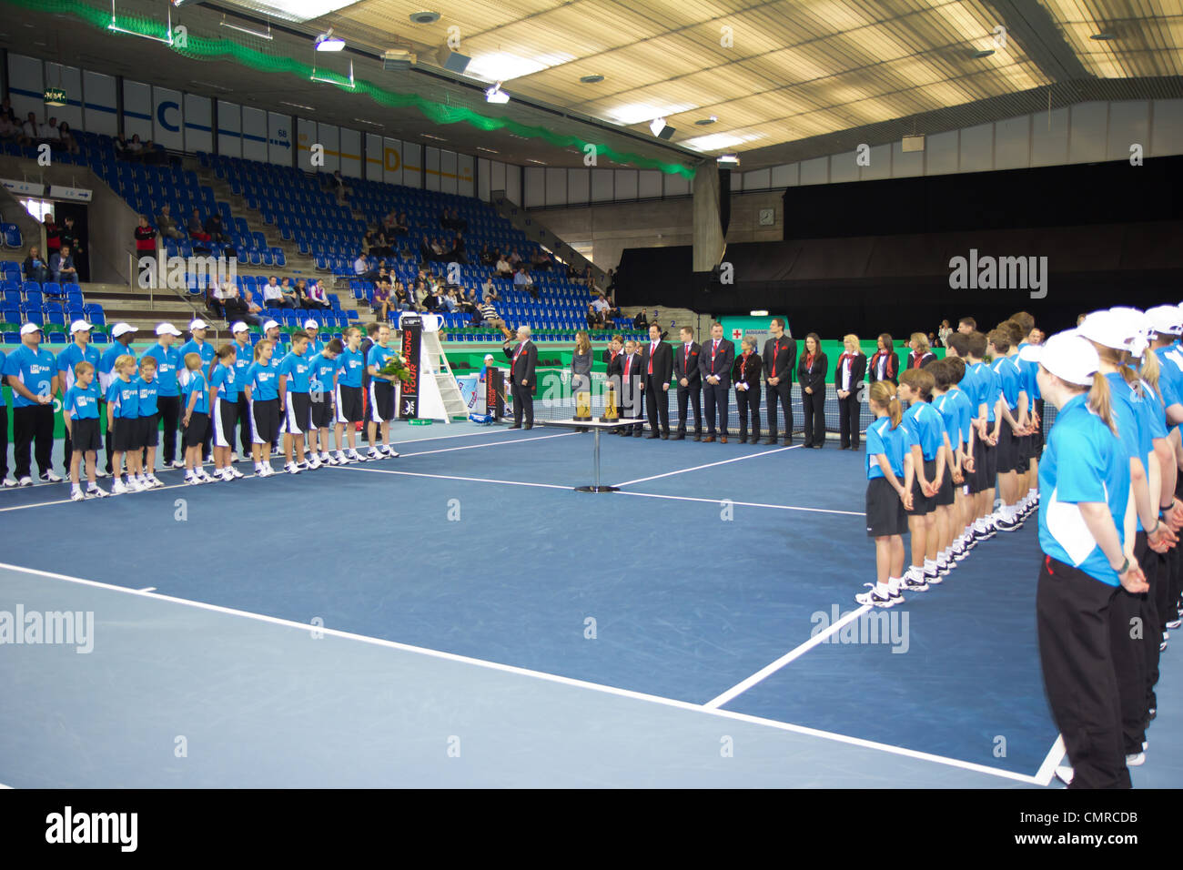 Officials, sponsors, linesmen and ball kids line up for award ceremony at BNP Paribas Open Champions - Stock Image