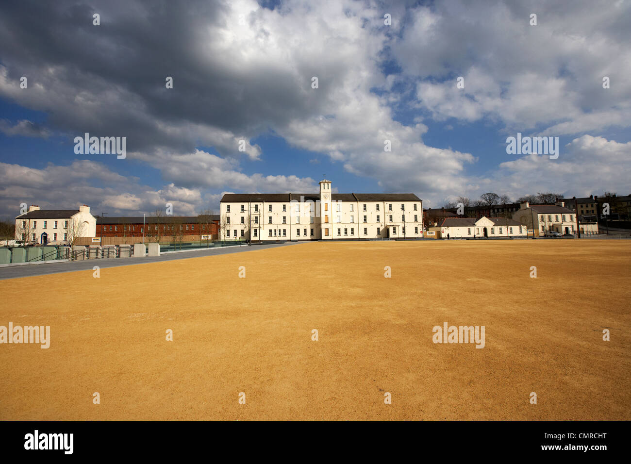 soldiers quarters with clock tower and parade ground in ebrington square former ebrington barracks british military - Stock Image
