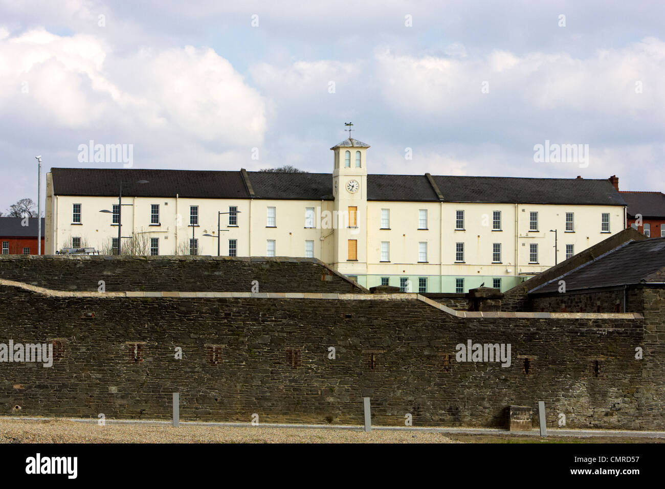 soldiers quarters with clock tower and defensive wall in ebrington square former ebrington barracks british military - Stock Image