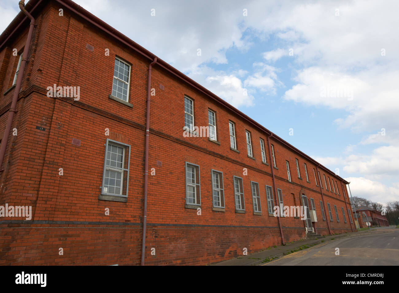 old red brick victorian british army barrack house in former ebrington barracks british military base Derry city - Stock Image