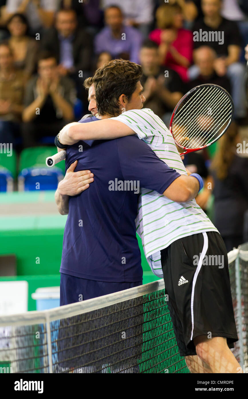 Mark Philippoussis (l.) and Marat Safin hug after the 3rd place match at BNP Paribas Open Champions Tour in Zurich, - Stock Image