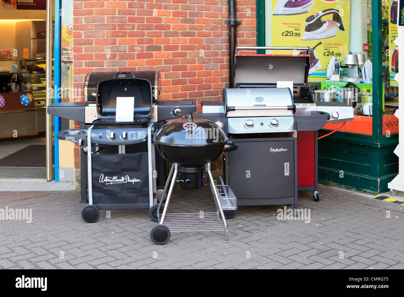Barbecue cookers for sale outside of a shop - Stock Image