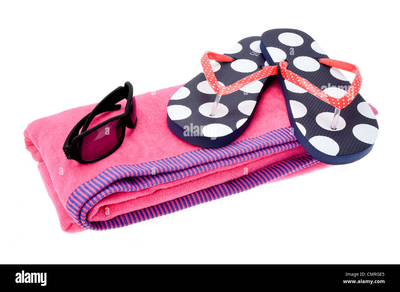 028b6d4ccd9587 Pink beach towel and a pair of flipflops and sunglasses on a white  background - Stock