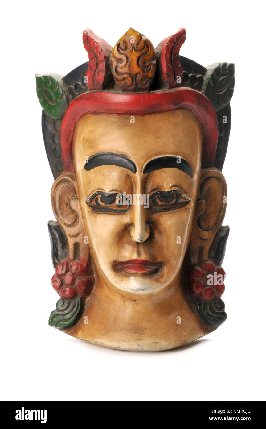 carved wooden mask of Indian diety - Stock Image