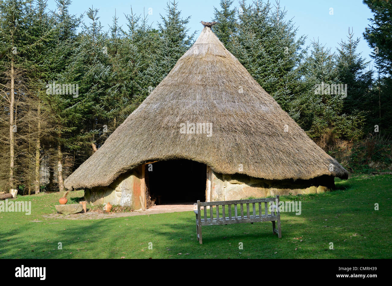 A replica of a bronze age roundhouse at bodrifty near penzance in cornwall, uk - Stock Image