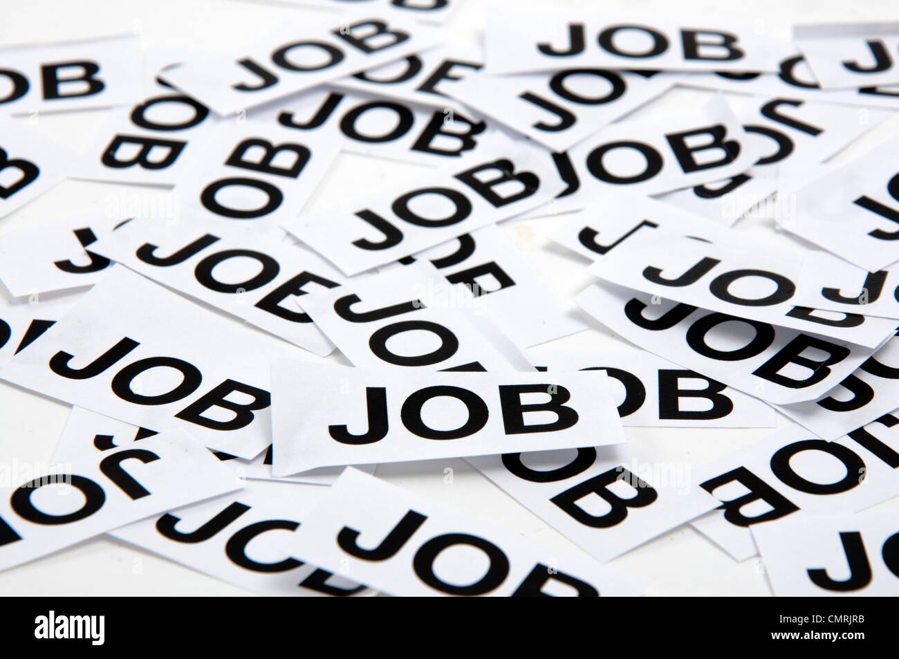 Printed paper notes with the word 'Job' in black ink - Stock Image