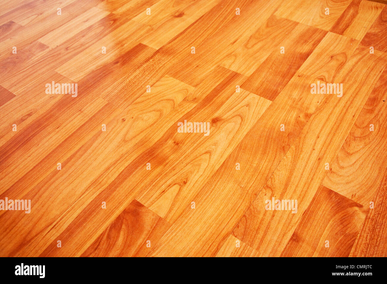 Close up detail of a beautiful wooden brown laminated floor - Stock Image