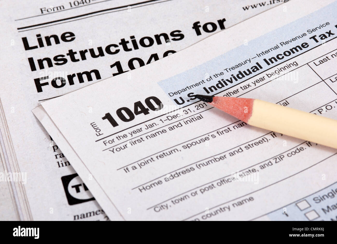 Close up of United States tax form, instruction book and pencil - Stock Image
