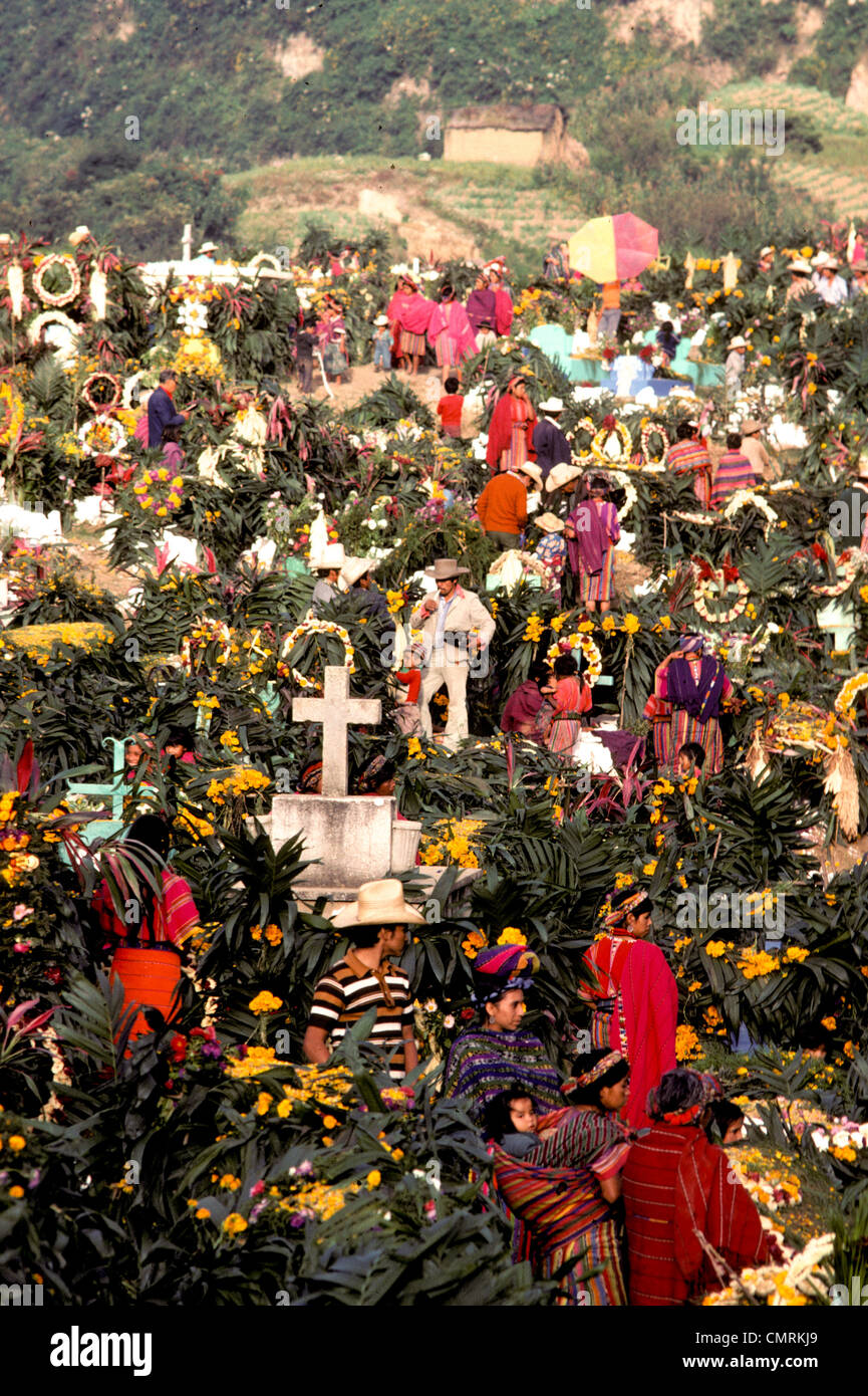 Indian families visit decorated graves in cemetery on Day of the Dead All Saints Todos Santos Day in Zunil Guatemala - Stock Image