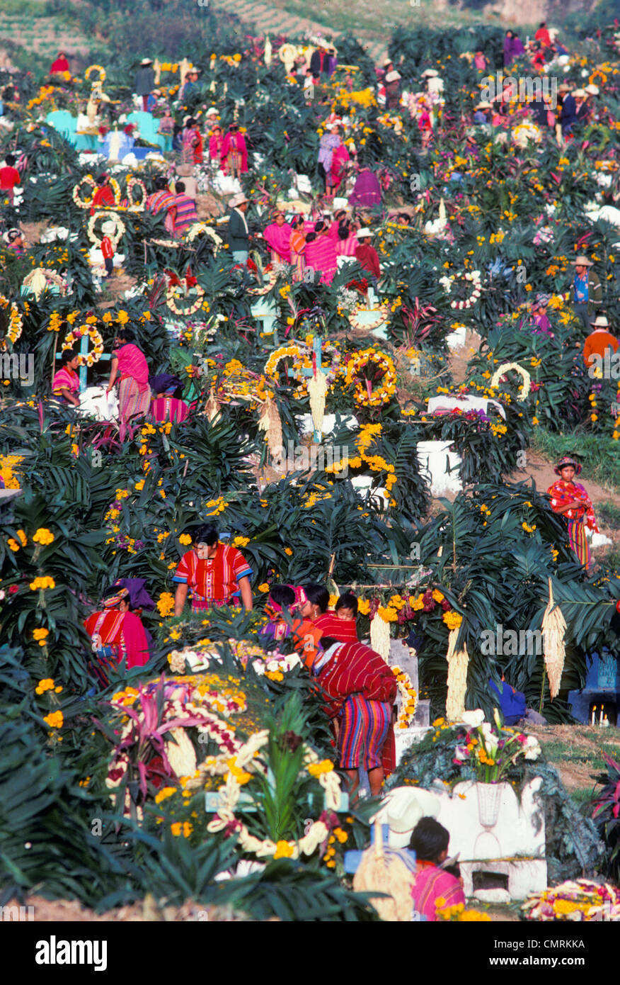 Indian families visit decorated graves in cemetery on All Saints Todos Santos Day of the Dead in Zunil Guatemala - Stock Image