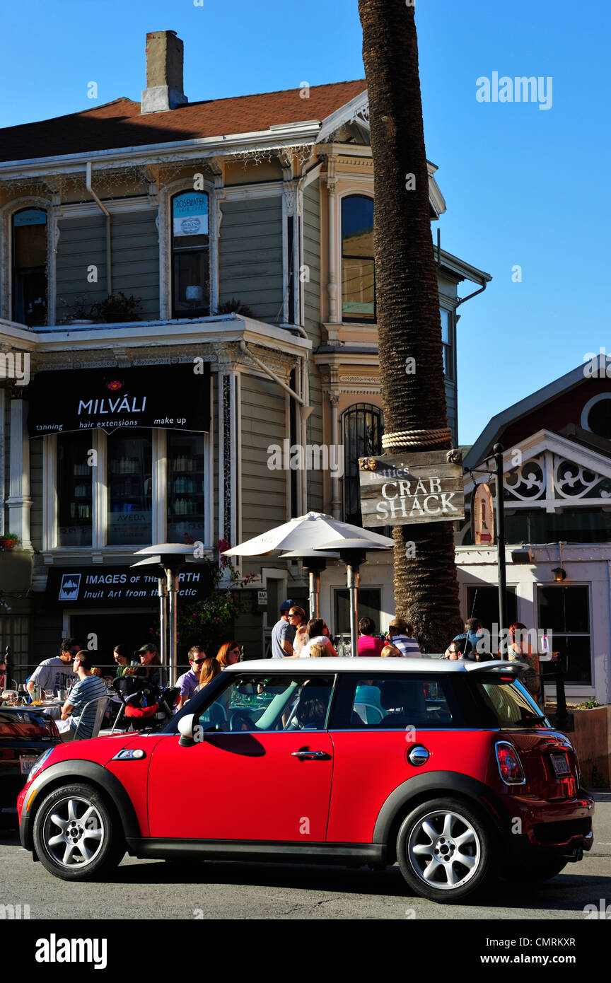 A red Mini Cooper in front of Nettie's Crab Shack, San Francisco CA - Stock Image