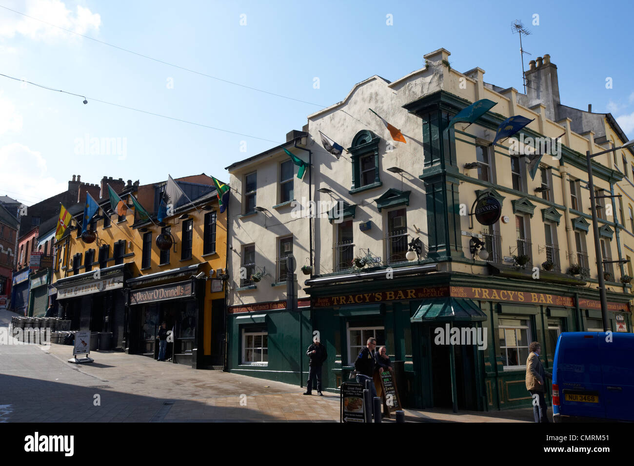 pubs at the junction of william street and waterloo street inside the walled city of Derry city county londonderry - Stock Image