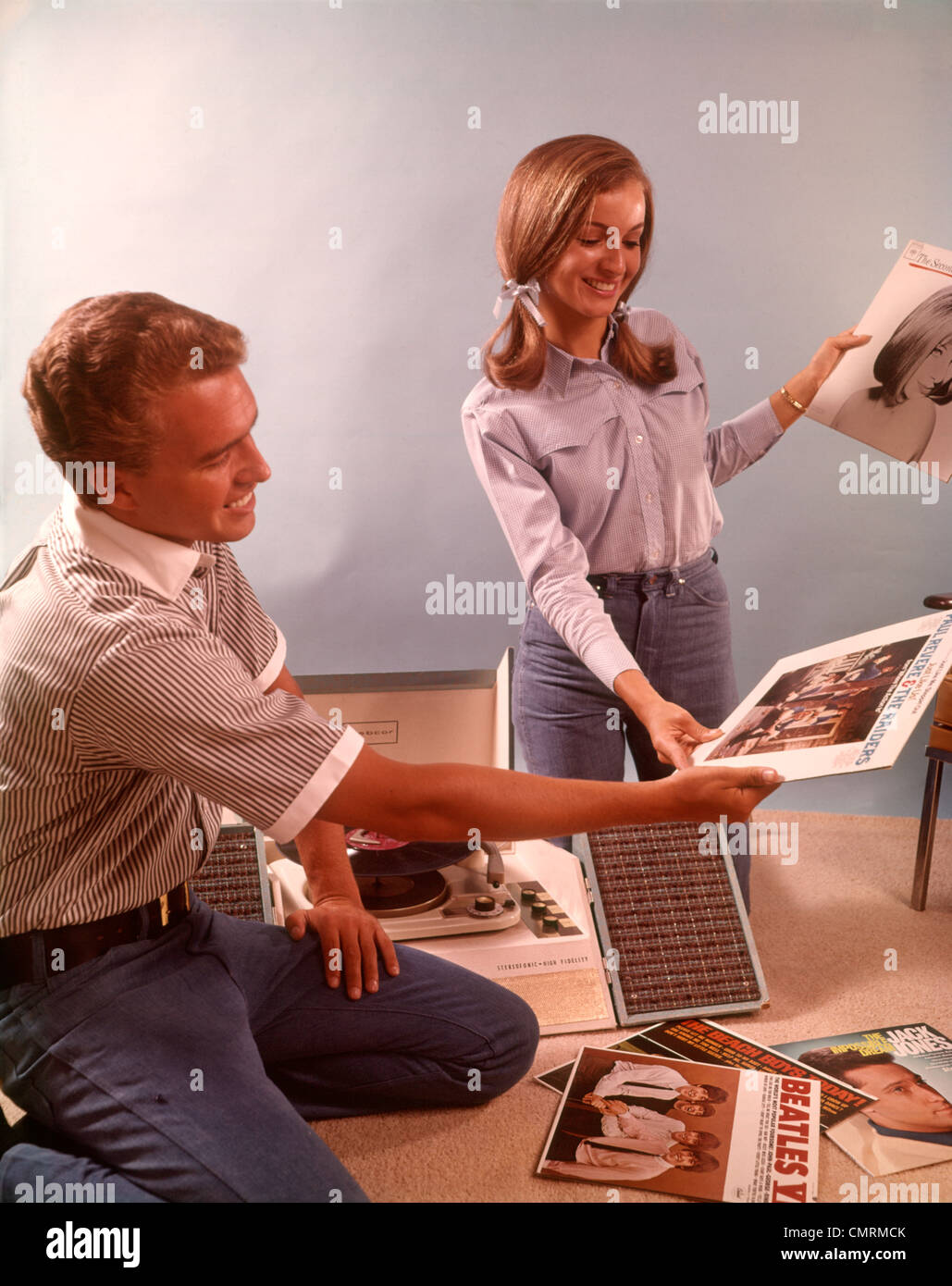 1960 1960s couple teen boy girl teens teenagers sorting vinyl record stock photo 47234787 alamy. Black Bedroom Furniture Sets. Home Design Ideas
