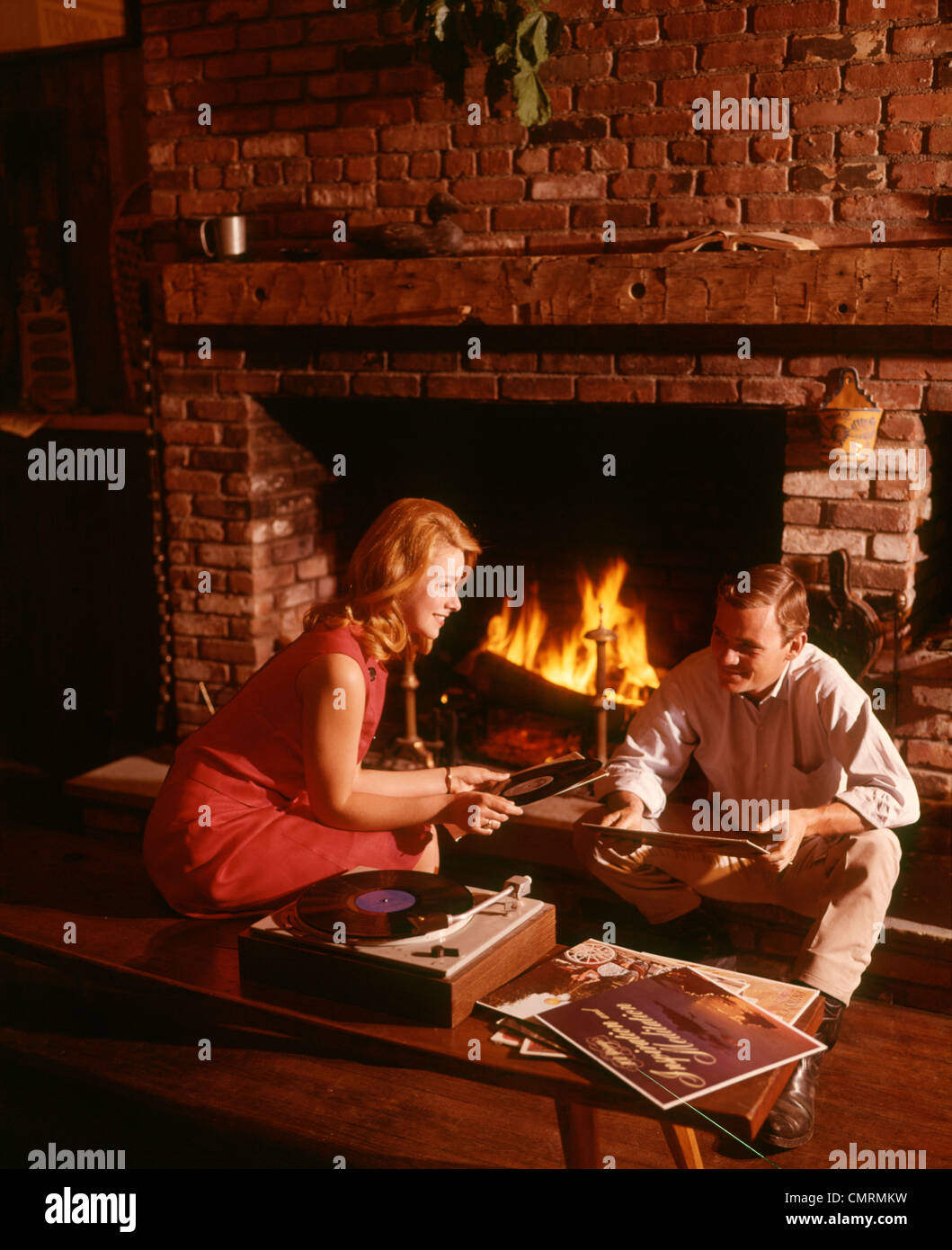 1960 1960s 1970 1970s COUPLE MAN WOMAN LIVING ROOM FIREPLACE RECORD