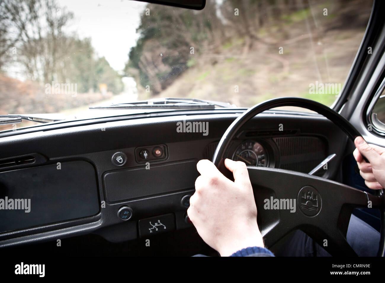 Driving Volkswagen Beetle type 1 - Stock Image