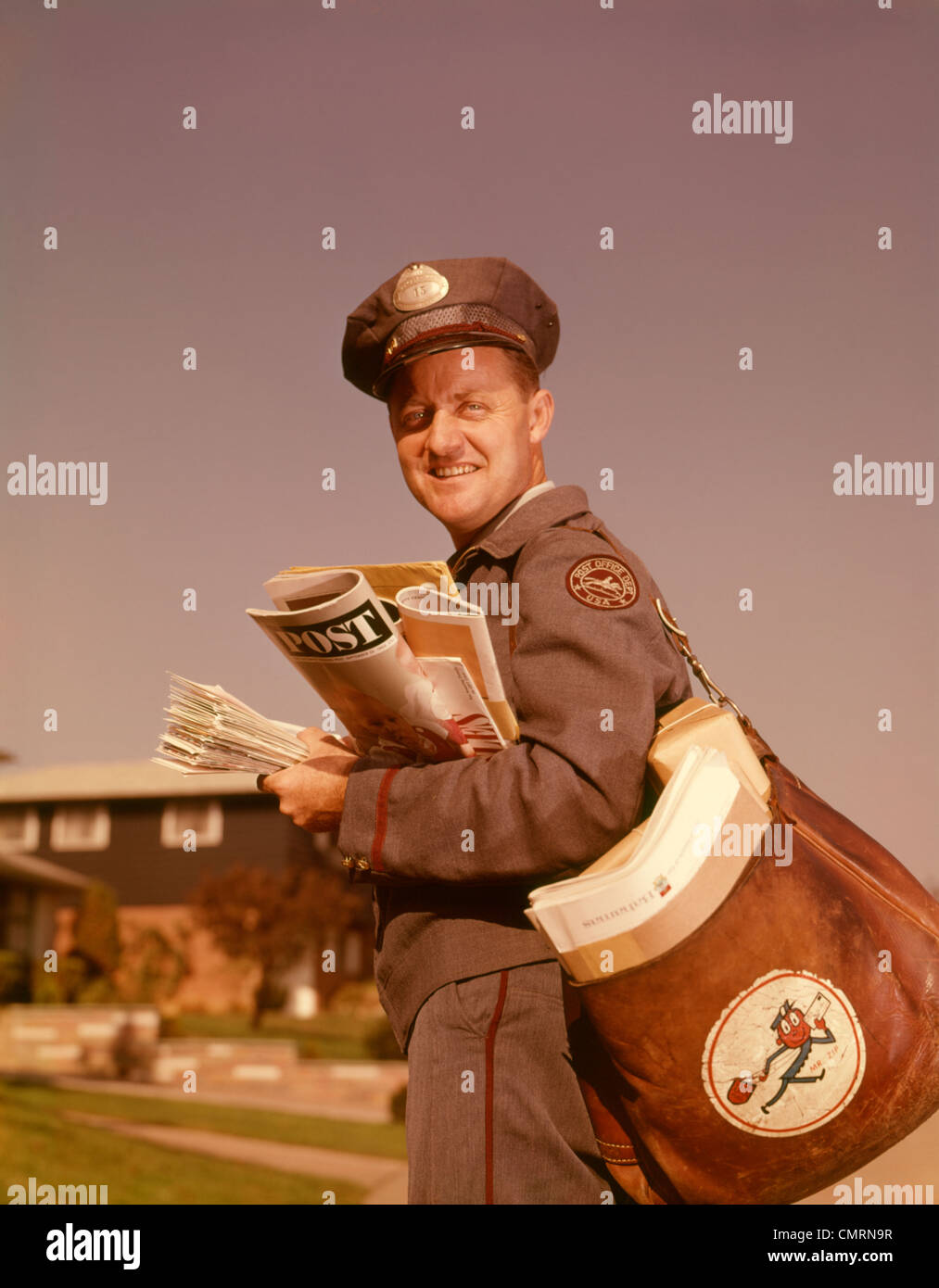 1960 1960s SMILING MAILMAN HOLDING MAIL MAILBAG LETTERS