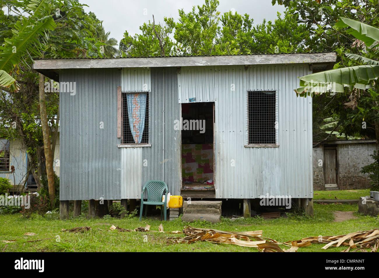 Corrugated iron house, Namaqumaqua village, Coral Coast, Viti Levu, Fiji, South Pacific - Stock Image