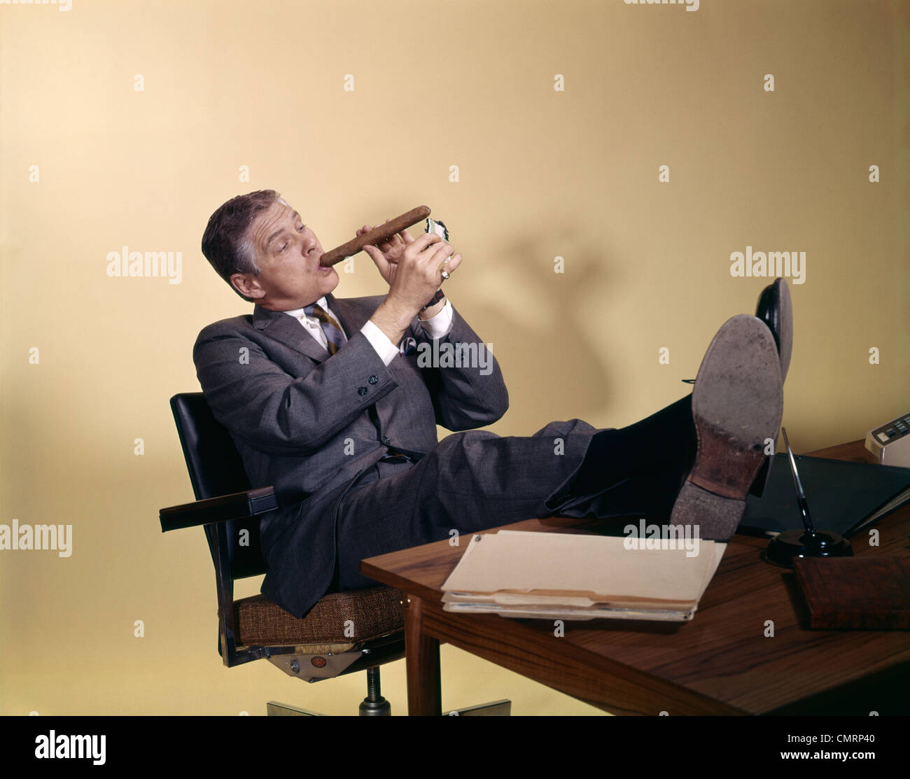 1960s Successful Businessman Sitting With Shoes Propped On