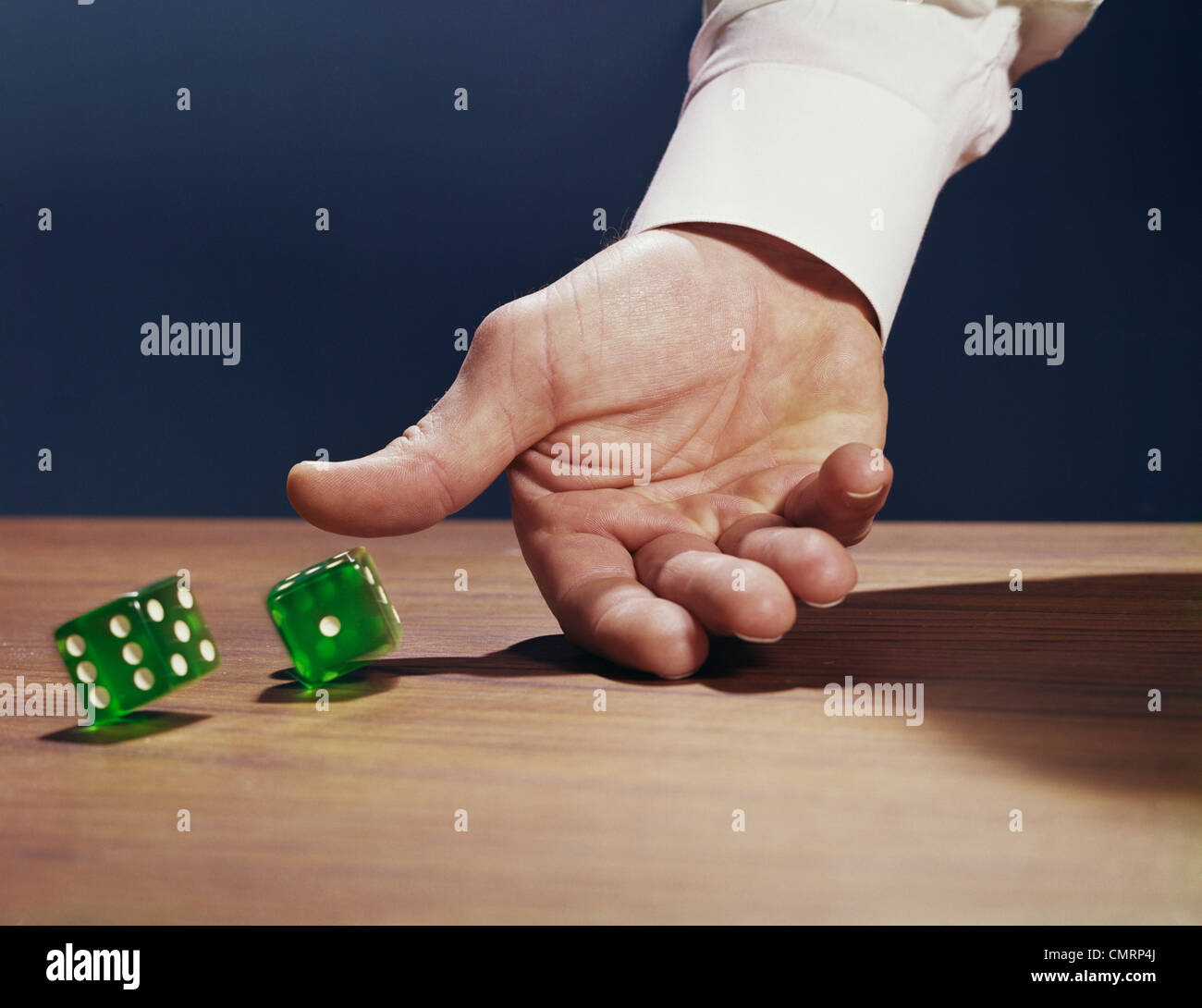 ROLE DICE HAND RETRO 1960 1960s - Stock Image
