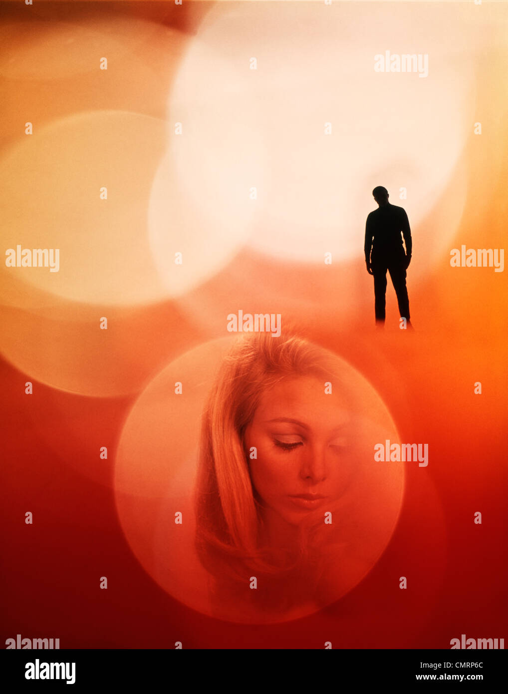 1970s 1970 LIGHT CIRCLES ON RED MAN IN SILHOUETTE & FACE OF WOMAN COUPLE SAD STRANGE SEPARATE MYSTERIOUS RETRO - Stock Image