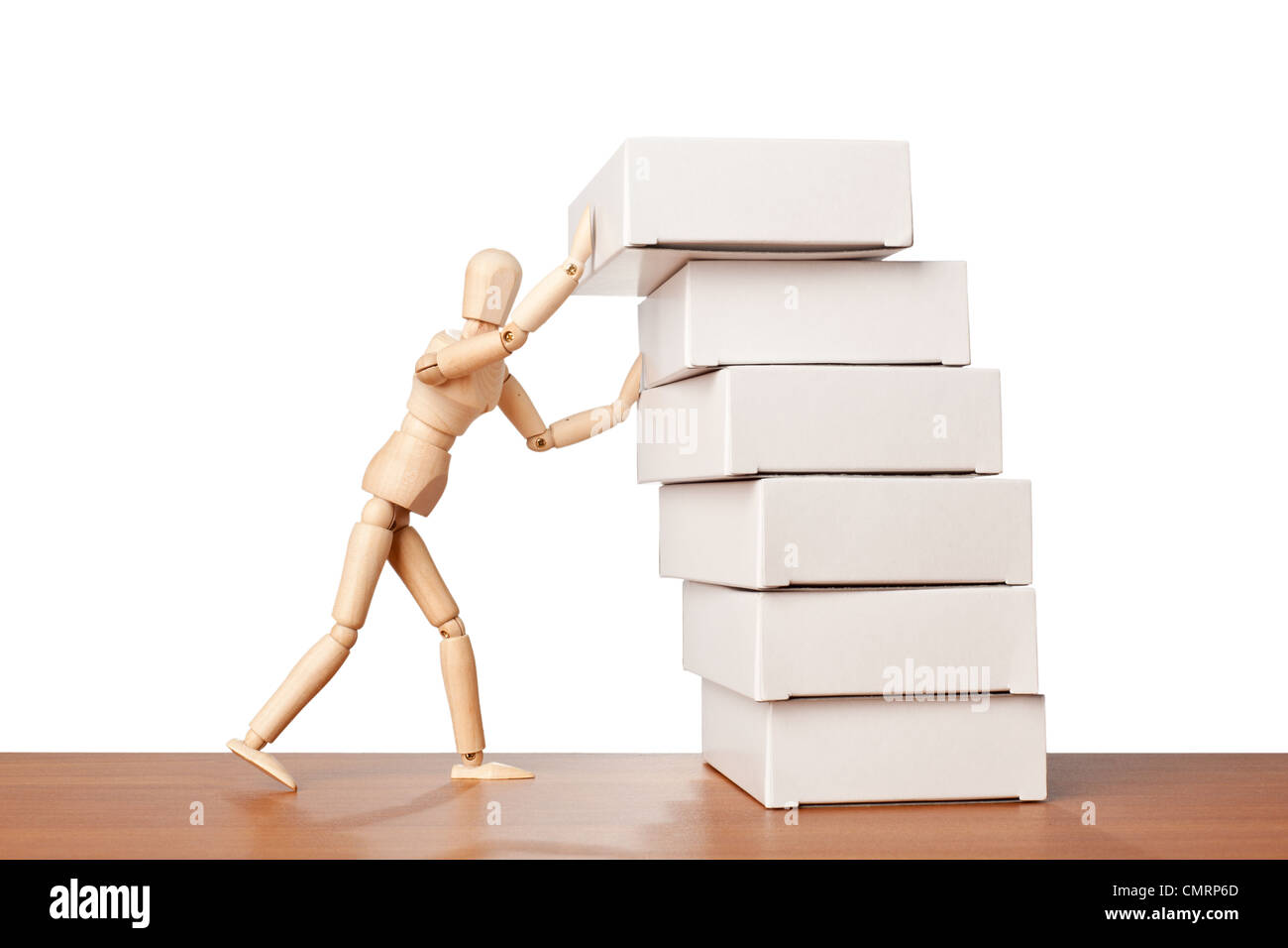 Figurine stacking a stack of white boxes - Stock Image