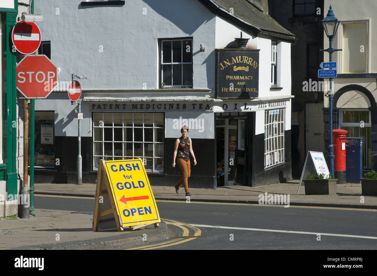 Cash for Gold sign in the town of Ulverston, Cumbria, England UK - Stock Image