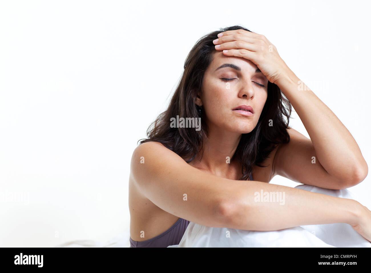 Beautiful woman suffering from headache Stock Photo