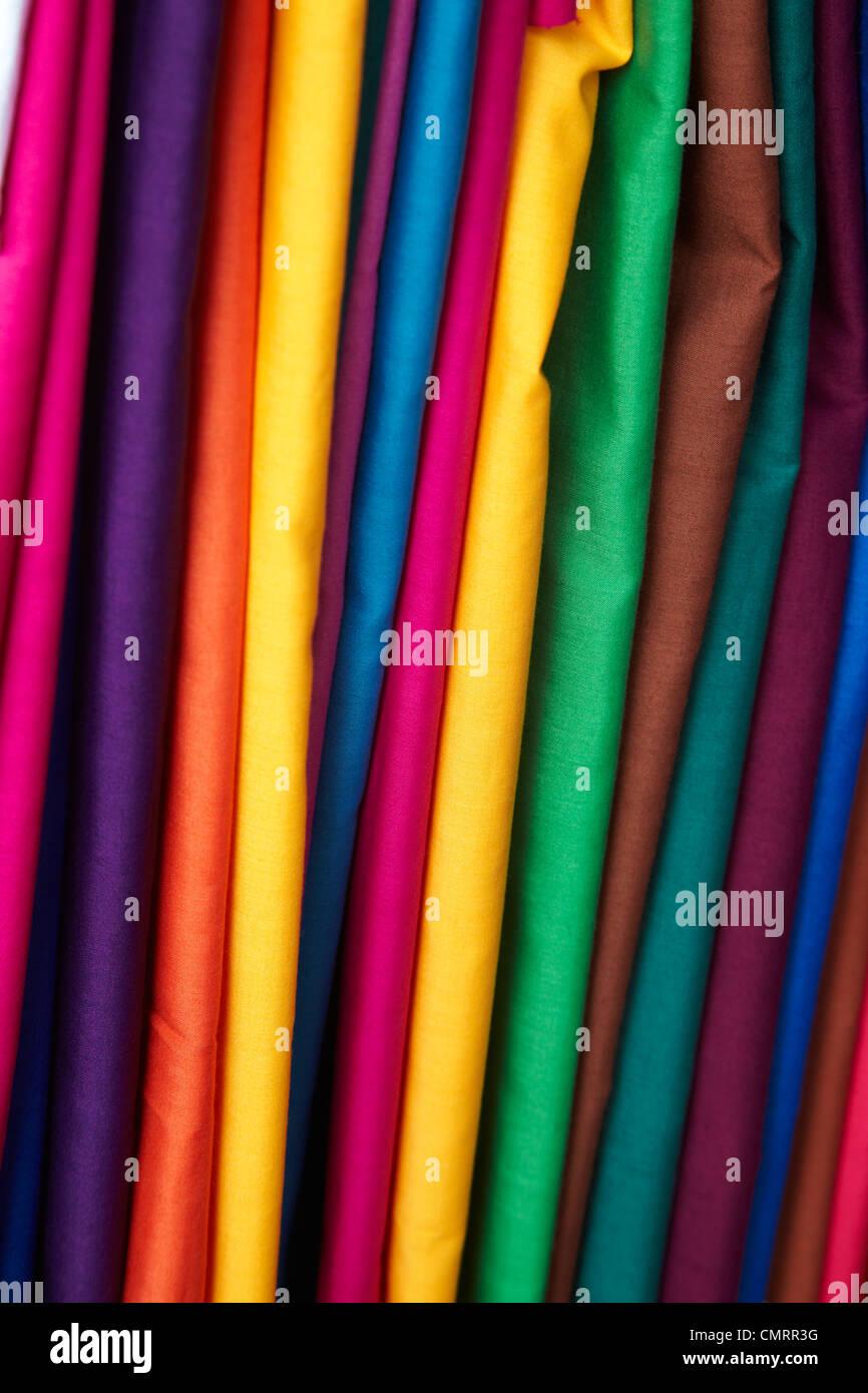 Brightly coloured material at Suva Flea Market, Suva, Viti Levu, Fiji, South Pacific - Stock Image