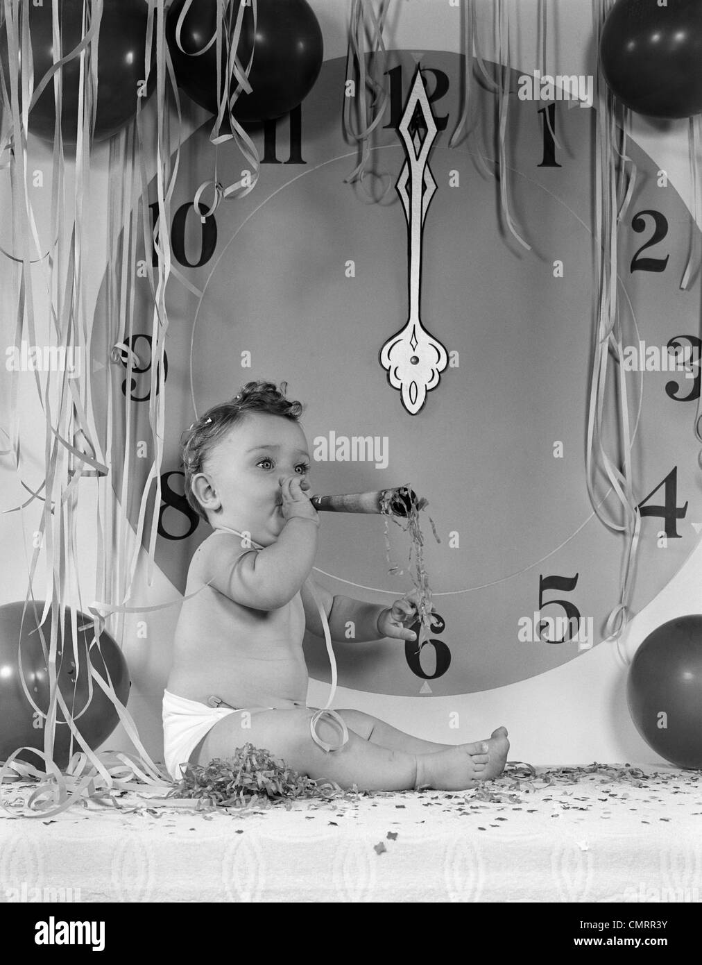 1950s New Year Baby Sitting By Midnight Clock Face Blowing Party