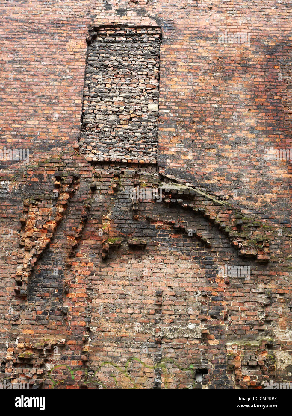 Remains of a demolished house in wall - Stock Image
