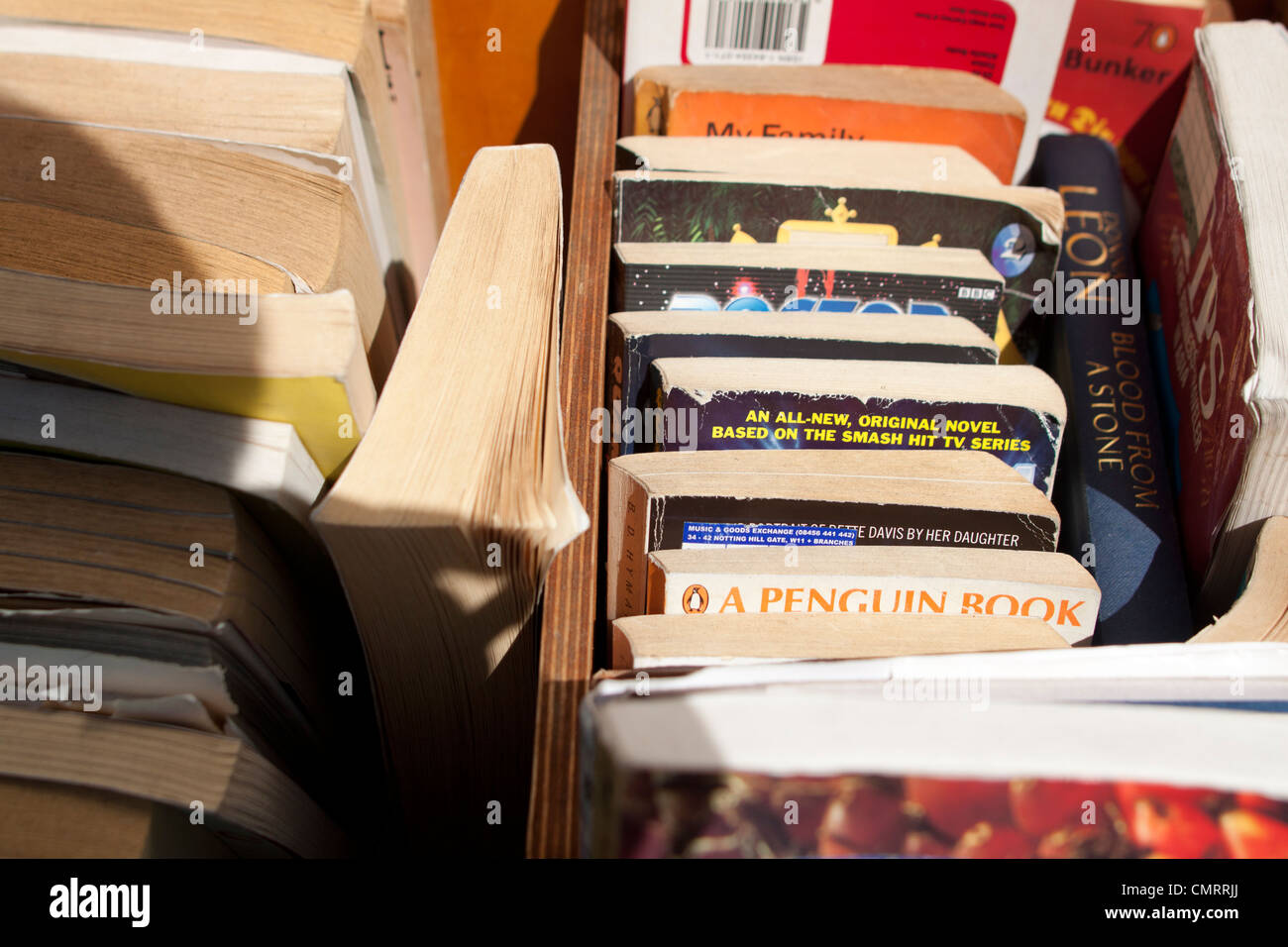A stack of second hand books at Notting Hill Markets. - Stock Image