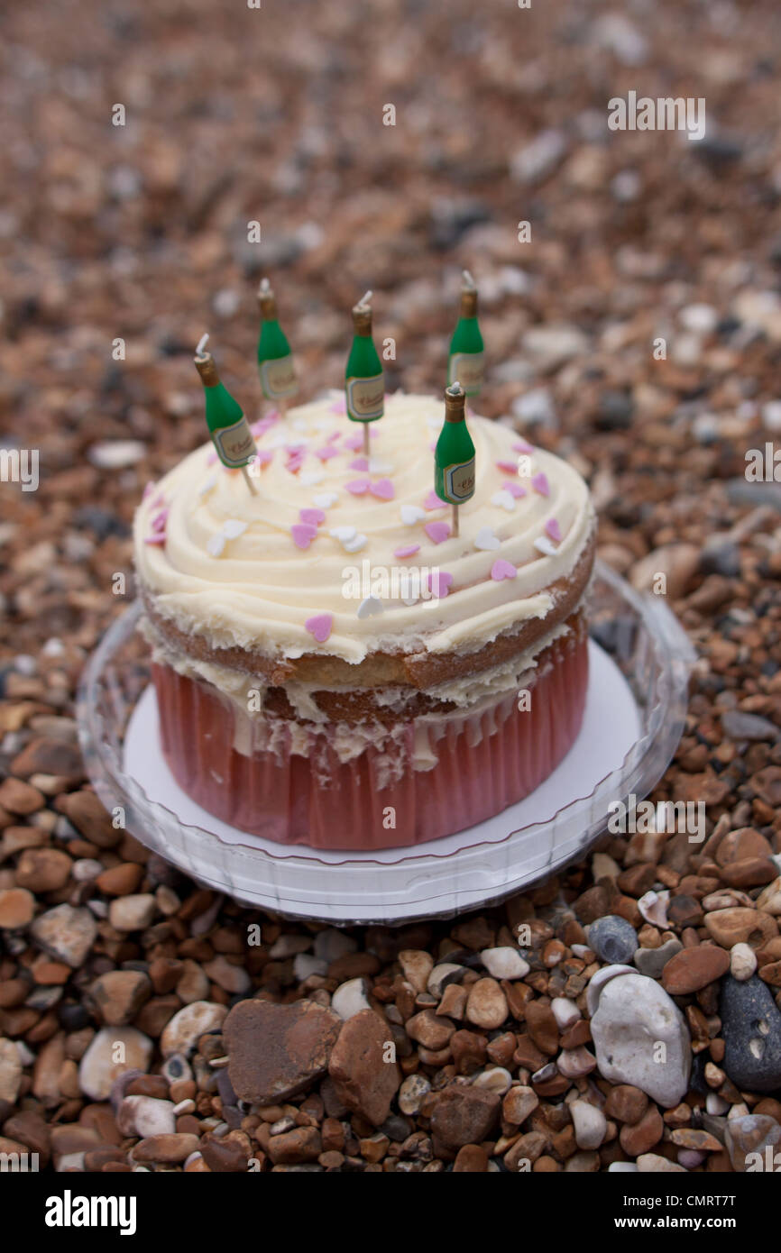 Phenomenal A Birthday Cake With Champagne Candles On A Pebbled Beach Stock Birthday Cards Printable Benkemecafe Filternl