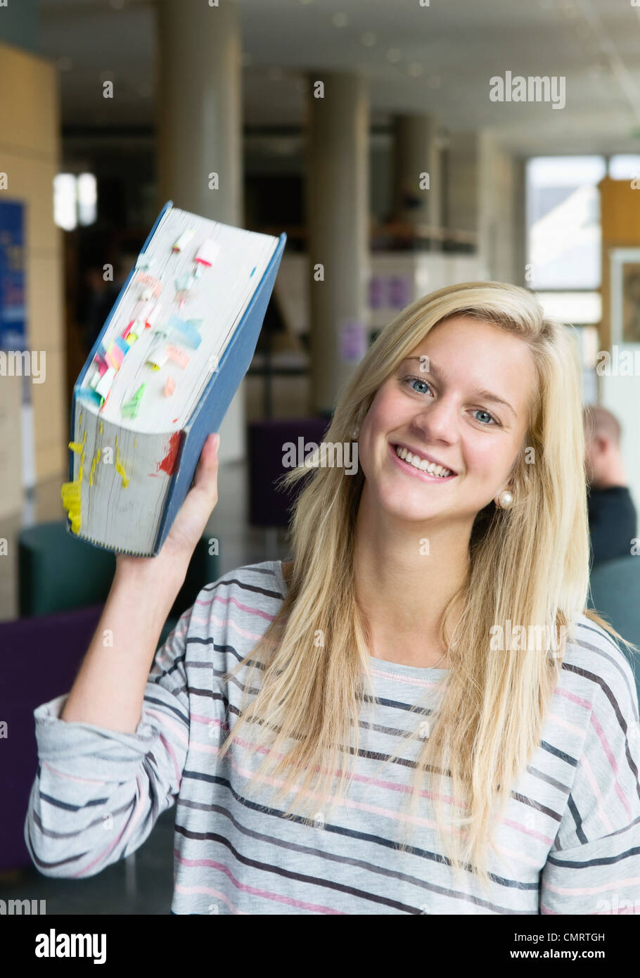 Woman holding book of reference - Stock Image