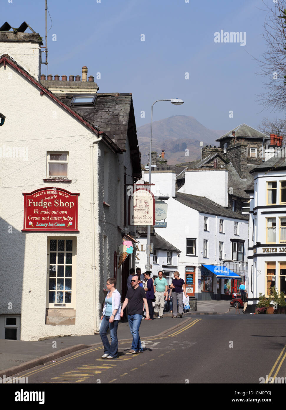 People walking down Lake Road past the Fudge Shop in Ambleside, Cumbria, NW England, UK - Stock Image
