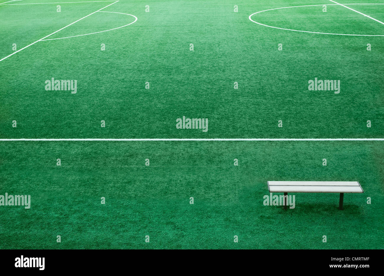Bench on football ground - Stock Image