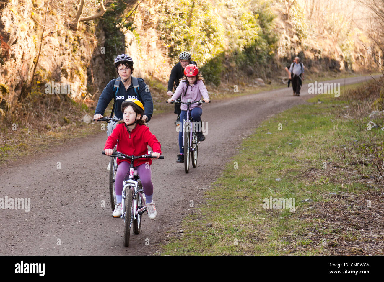 The monsal trail in Derbyshire.A family cycling. - Stock Image