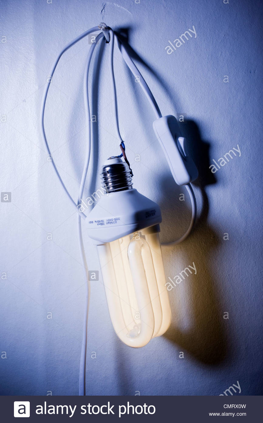 Low-energy bulb on the wall - Stock Image