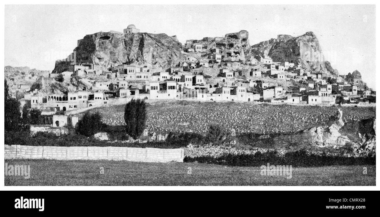 1919 Urgup Burgut Kalesi Nevşehir Province Central Anatolia Turkey. Cappadocia cave - Stock Image