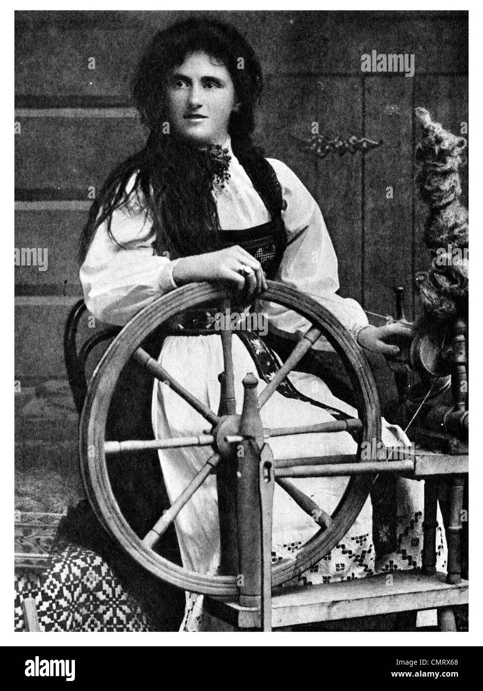 1919 Norway spinning wheel dress maker Stock Photo