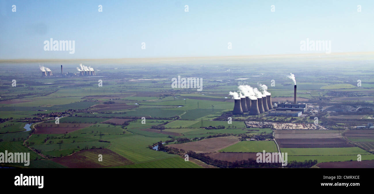 aerial view of Eggborough (foreground) and Drax Power Stations and a brown coloured Inversion layer of pollution - Stock Image