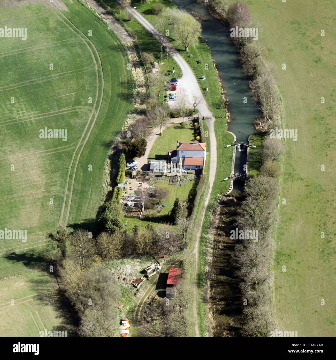 Aerial view of canal lock and lock keepers cottage - Stock Image