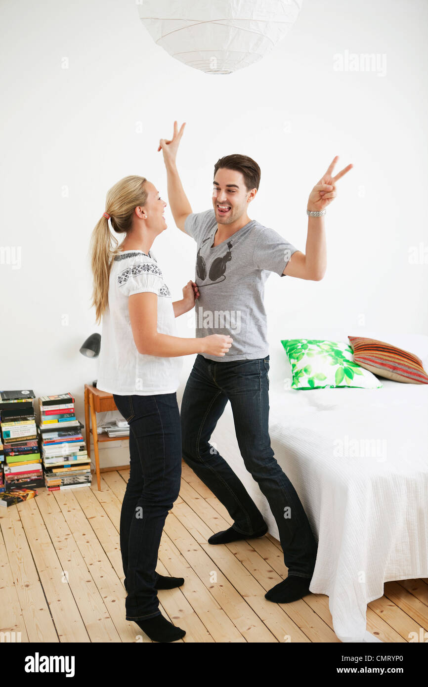 Couple dancing in the bedroom - Stock Image