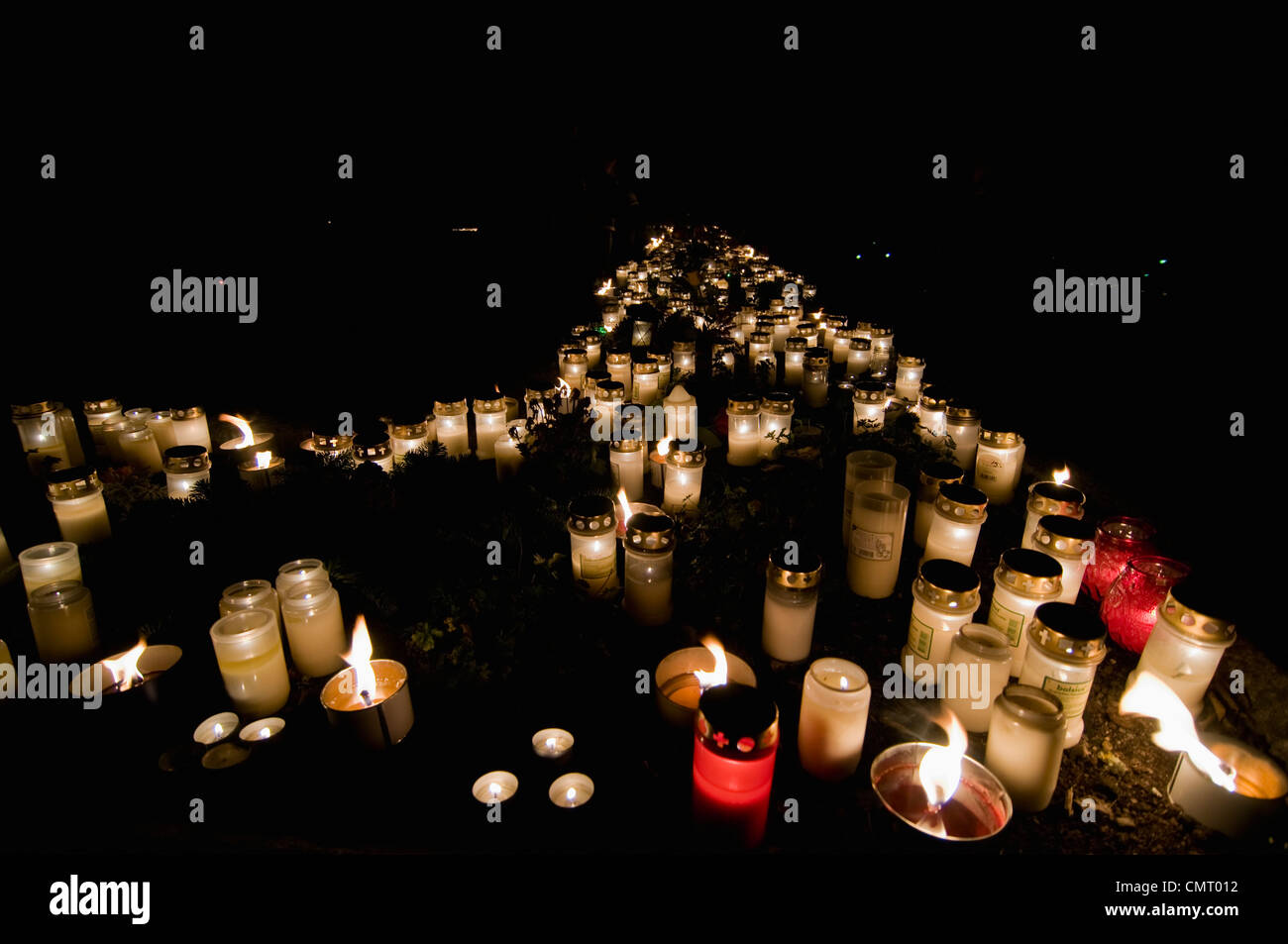 Large group of tea lights arranged in memories - Stock Image