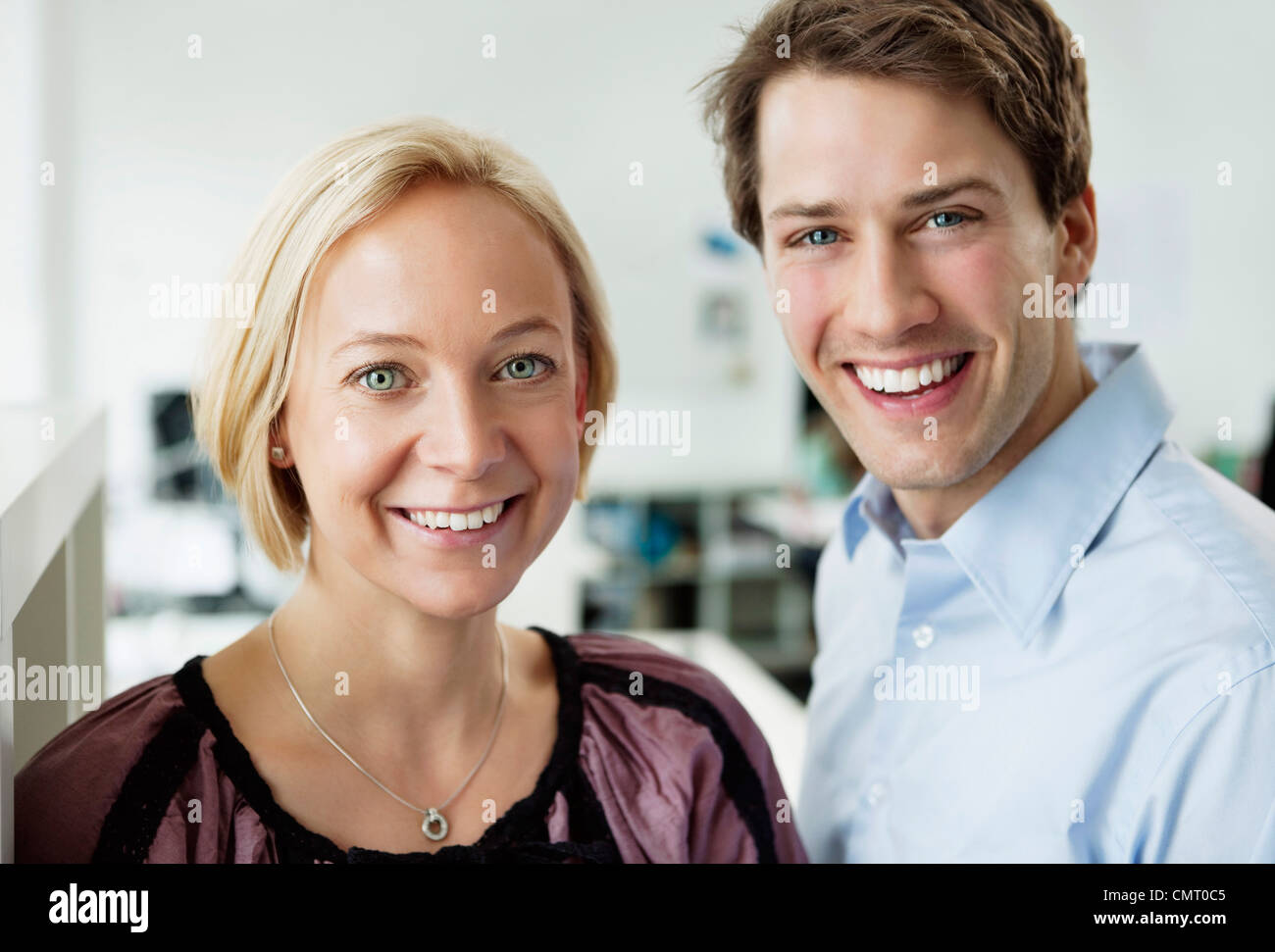 Portrait of smiling coworkers - Stock Image